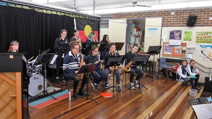 Students in the band performing on stage at a local primary school.