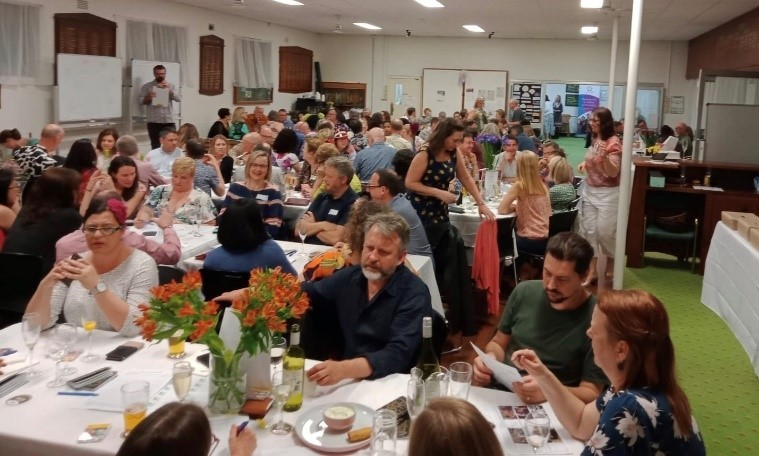 A function room full of people at tables enjoying the P and C Trivia Night